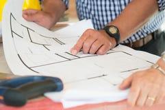 显示在图纸的建筑师计划 免版税库存图片