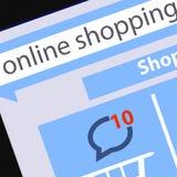 显示在屏幕购物车平的设计网上购物概念和计算机科技e-commer的现代空白的片剂个人计算机屏幕 库存图片
