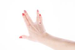 显示在白色的女性手标志孔 库存图片