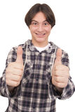 显示赞许的英俊的微笑的少年 免版税库存照片