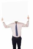 显示在他的头前面的商人白色海报 免版税库存图片