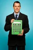 显示大绿色计算器的总公司人 免版税库存图片