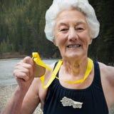 显示奖牌的女性游泳者画象的综合图象 库存照片
