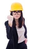 显示她的拳头的黄色盔甲的恼怒的女商人建筑师 免版税图库摄影