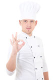 显示好标志的年轻英俊的人厨师被隔绝在白色 库存照片