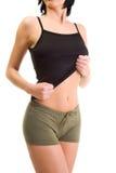 显示妇女年轻人的腹部 免版税库存照片