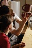 显示实习教师的水罐瓦器 免版税图库摄影