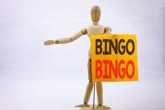显示宾果游戏在的概念性手文字文本说明启发赢取价格成功writte的赌博上写字企业概念 免版税图库摄影