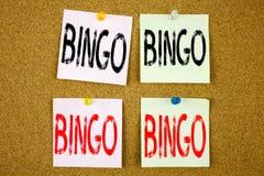 显示宾果游戏在的概念性手文字文本说明启发赢取在的价格成功的赌博上写字企业概念 免版税库存照片