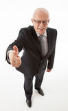 显示微笑的赞许的生意人 免版税库存照片