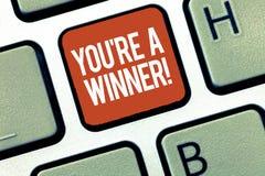 显示您关于的文本标志是优胜者 赢取作为第1个地方或冠军的概念性照片在竞争中 免版税库存照片