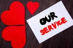 显示我们的服务的文字文本 概念意思顾客市场支持帮助您的客户的帮助概念写在notobook 图库摄影