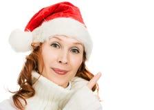 显示手指的美丽的圣诞节妇女  库存照片