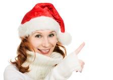 显示手指的美丽的圣诞节妇女  库存图片