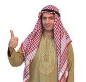 显示拇指的阿拉伯商人隔绝了与剪报的背景 图库摄影