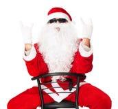 显示摇摆物现有量符号的圣诞老人 库存照片