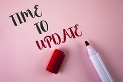 显示时刻的概念性手文字更新 更新变动的企业照片陈列的更新需要整修现代化 库存照片