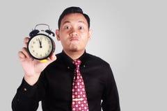 显示时钟的恼怒的上司 免版税库存图片