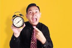 显示时钟的恼怒的上司 库存图片