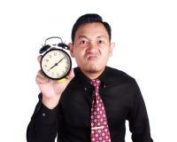 显示时钟的恼怒的上司 免版税库存照片