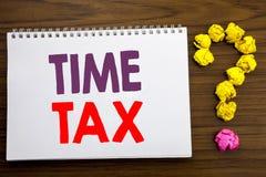 显示时间税的概念性手文字说明启发 征税财务提示的企业概念被写在没有的笔记薄 图库摄影