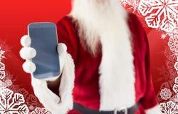 显示智能手机的圣诞老人的综合图象 免版税图库摄影