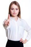 显示标志的白色背景的年轻可爱的企业女孩 库存图片