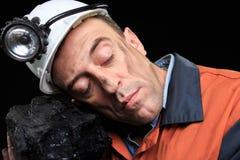 显示煤炭的团与赞许的煤矿工人 库存照片