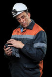 显示煤炭的团煤矿工人 库存图片