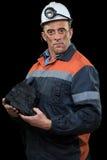 显示煤炭的团煤矿工人 图库摄影
