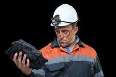 显示煤炭的团煤矿工人 免版税库存图片