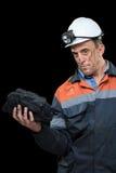 显示煤炭的团煤矿工人 免版税图库摄影