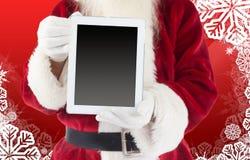 显示片剂个人计算机的圣诞老人的综合图象 库存图片