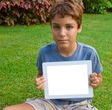 显示片剂个人计算机的男孩 库存照片