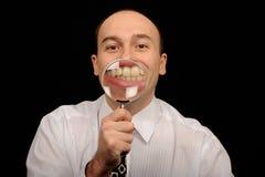 显示牙的生意人 图库摄影