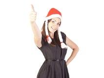 显示现有量好的符号的圣诞老人女孩 图库摄影