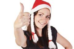显示现有量好的符号的圣诞老人女孩 免版税库存图片
