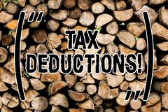 显示税收减免的概念性手文字 企业照片文本能被收税的减少收入 库存照片