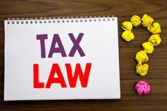 显示税法的概念性手文字说明启发 征税在笔记薄笔记pape写的税收规则的企业概念 免版税图库摄影