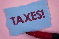 显示税诱导电话的文字笔记 企业照片陈列的金钱由它的书面的支持的一个政府要求了  免版税库存照片