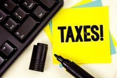 显示税诱导电话的文字笔记 企业照片陈列的金钱由它的书面的支持的一个政府要求了  库存图片