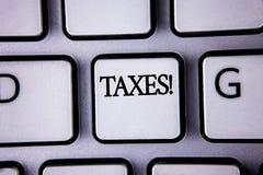 显示税诱导电话的文本标志 概念性照片金钱由在白色Keyboa写的它的支持的一个政府要求了 库存图片
