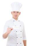 显示空白的名片的制服的年轻人厨师被隔绝 免版税库存图片