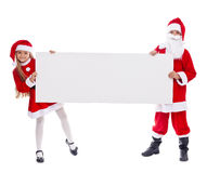 显示空白的标志的圣诞老人和帮手 免版税库存照片