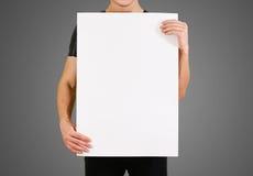 显示空白的白色大A2纸的人 传单介绍 图库摄影