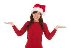 显示空的棕榈的亚裔圣诞节女孩 免版税库存照片