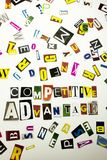 显示竞争优势的概念词文字文本由企业案件的另外杂志报纸信件制成在 图库摄影