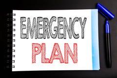 显示紧急办法的手写的文本 企业在笔记薄便条纸写的灾害保护的概念文字,黑bac 库存图片