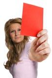 显示红牌的妇女裁判员 免版税库存照片
