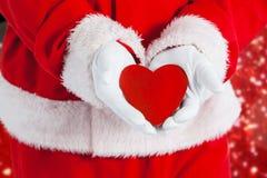 显示红色心脏形状的圣诞老人的综合图象 库存照片